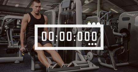 competitions: Digital composite of Clock icon against man exercising photo