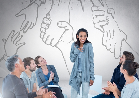 Digital composite of Group of business people sitting in circle meeting in front of hands reaching for each other drawing