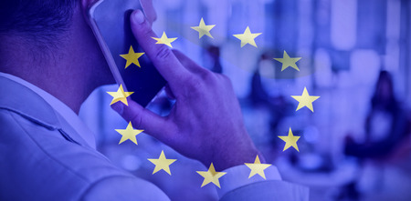 phoning: European flag against businessman talking on mobile phone Stock Photo