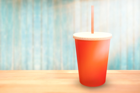 Red cup over white background against view of wooden planks Imagens