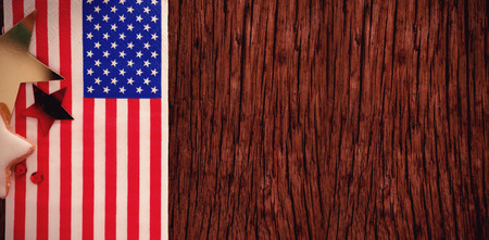 American flag and star shape decoration arranged on wooden table with 4th July theme