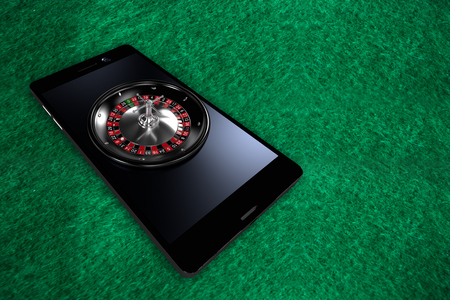 3D image of smartphone with roulette wheel against full frame shot of playing field