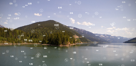 Sphere of icons and numbers against calm river and mountains against sky