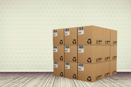 Composite image of cardboard boxes against room with wooden floor Stock Photo