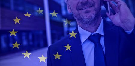 European flag against businessman talking on mobile phone Stock Photo