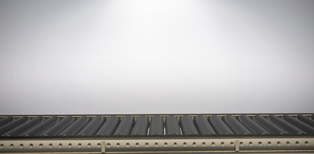 Digital image of empty conveyor belt against grey background