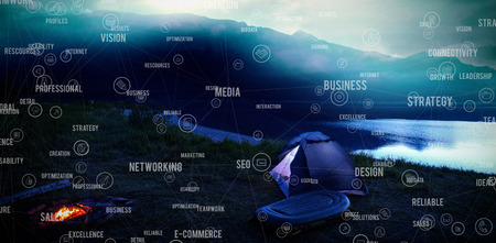 mountaintop: Sphere of icons and words against tent standing beside lake in the evening
