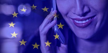 European flag against businesswoman talking on mobile phone Stock Photo