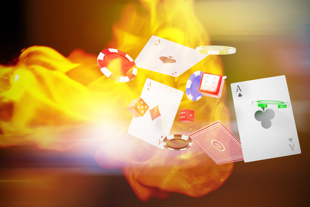 3D image of casino tokens with playing cards and dice against defocused image of illuminated lighting equipment Stock Photo