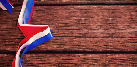 earth day: Red white and blue ribbons on wooden table Stock Photo