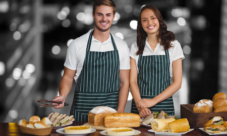 single word: Portrait of coworker standing by table with food against glowing road in city at night Stock Photo