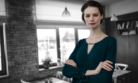 ceiling: Portrait of beautiful young woman standing with arms crossed against empty chairs and tables