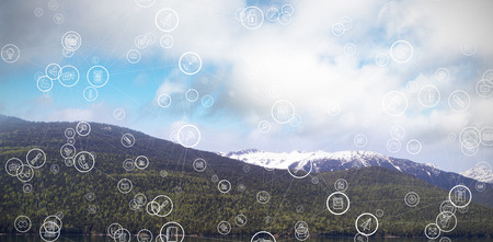 wireless icon: Sphere of icons against mountains by river against sky Stock Photo