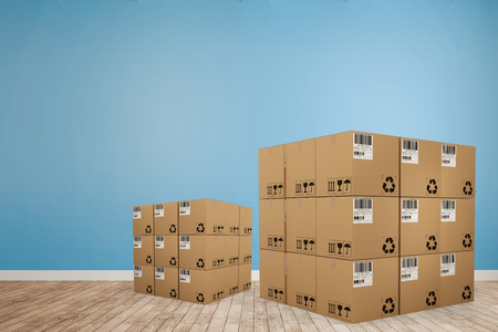 Digitally generated image of cardboard boxes against room with wooden floor Stock Photo