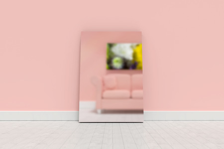 Blank whiteboard leaning on wall  against 3d illustration of coral sofa with cushions