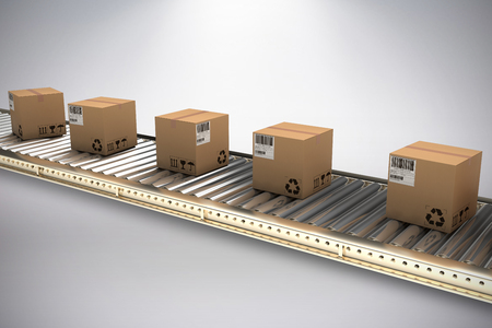 Cardboard boxes on production line against grey background