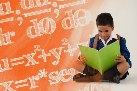 Digital composite image of algebraic formulas against schoolboy reading book on white background Stock Photo