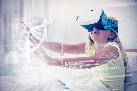 Illustration of DNA against girl using virtual reality simulator on bed Stock Photo
