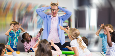 Frustrated teacher with naughty students against interior of empty classroom