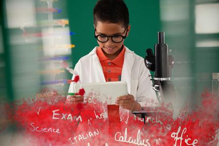 scholarship: Text on black chalkboard against schoolboy using digital tablet