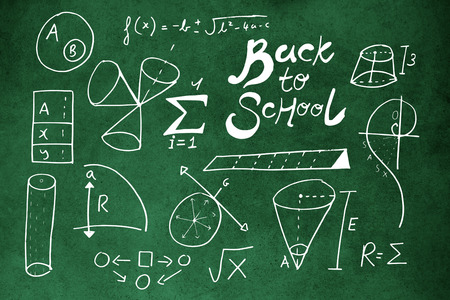 Back t o school text with geometric shapes against close-up of blackboard Banco de Imagens