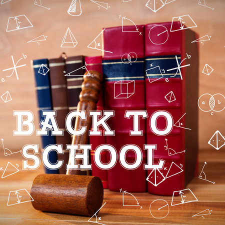defocussed: Back to school message against gavel with books Stock Photo