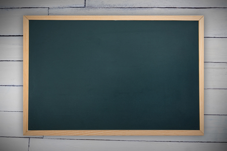 Chalkboard against wood panelling Stock Photo