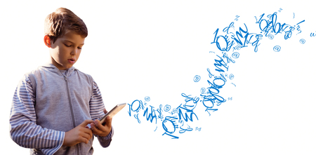 defocussed: Boy using digital tablet against letter and number jumble