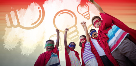 Low angle view of children in superhero costumes against orange and yellow abstract backgrounds