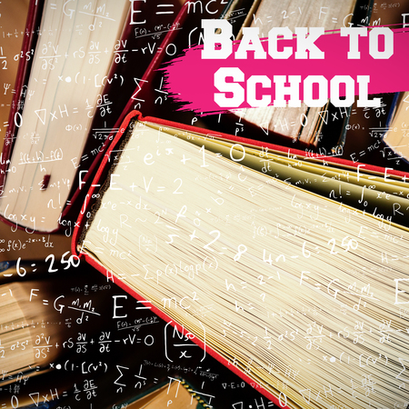 defocussed: Back to school message against close-up of books arranged