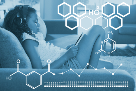 Digital image of chemical structure against side view of girl using digital tablet on sofa Stock Photo