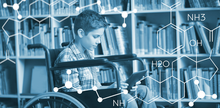 Composite image of chemical structure against disabled schoolboy using digital tablet in library