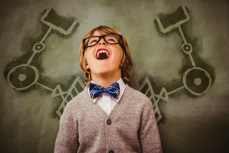 Gardening equipment against white background against boy laughing in front of blackboard