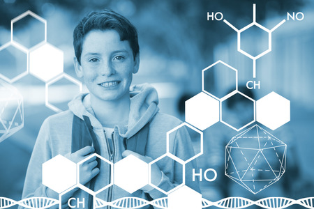 dna smile: Graphic image of chemical structure against smiling schoolboy standing with schoolbag in campus