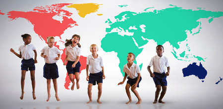 Happy students in school uniforms against grey background