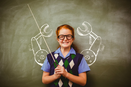 Illustrative image of hand tool against llittle girl holding stick in front of blackboard