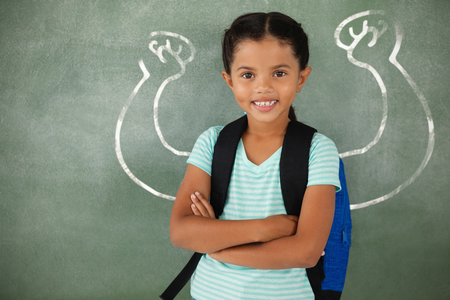Vector image of hand flexing muscles against portrait of cute school girl standing with arms crossed