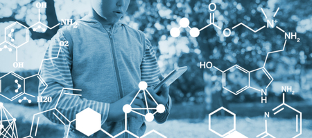 cytosine: Digitally generated image of chemical structure against little boy using mobile phone in forest Stock Photo