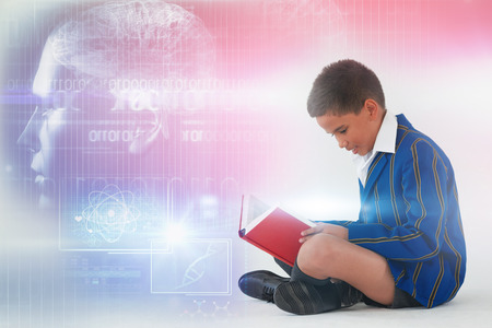 Digitally image of brain interface against schoolboy reading book on white background Stock Photo