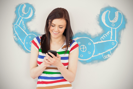 Work tool against white background against smiling girl using her mobile phone