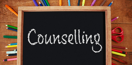 Counselling text against white background against high angle view of empty chalkboard with colorful equipment