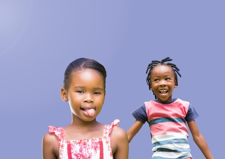 Digital composite of kids fooling around playing with blank purple background Stock Photo