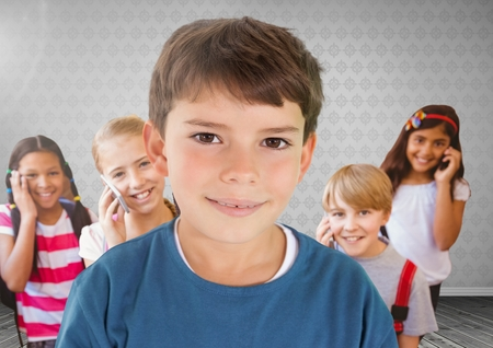 Digital composite of Kids in room on phones Stock Photo