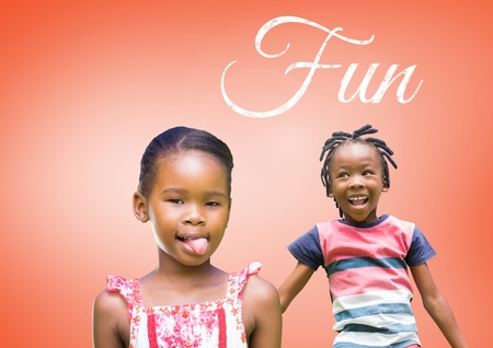 Digital composite of Fun text with kids fooling around playing with blank orange background Фото со стока
