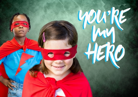 Digital composite of Youre my hero text with Superhero kids in front of green background Stock Photo