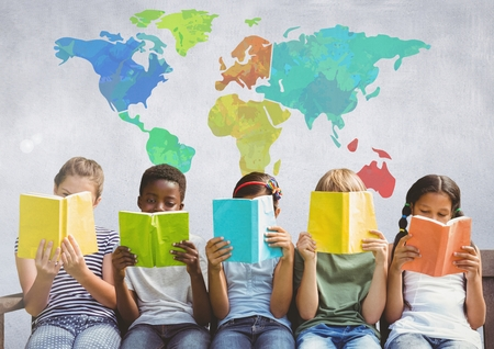 Digital composite of Group of children sitting and reading in front of colorful world map 版權商用圖片 - 83070500