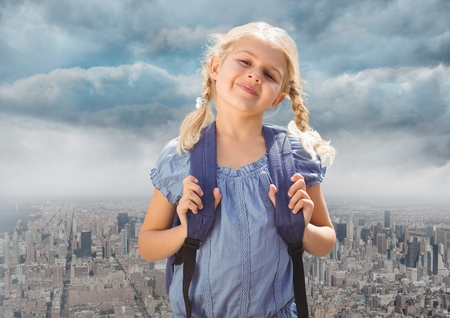 Digital composite of Blonde Girl in front of city 写真素材