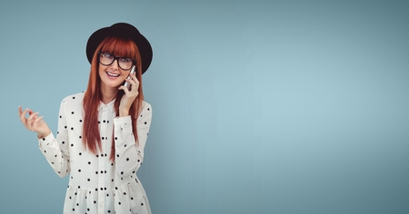 Digital composite of Happy woman talking on the phone against blue background