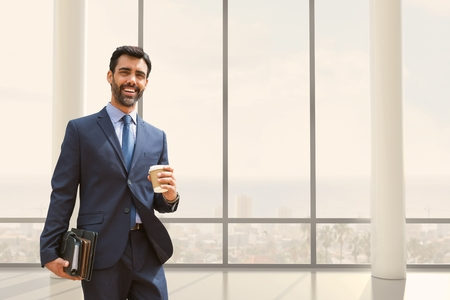 businesswear: Digital composite of Happy business man standing against building background Stock Photo