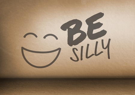 Digital composite of Be Silly text and smiley face in room Фото со стока